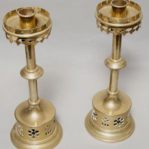 A pair of brass candlesticks-163