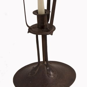 A pair of iron & copper candlesticks-63