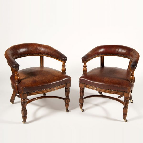 A pair of oak arm chairs -0