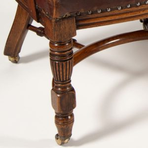 A pair of oak arm chairs -261