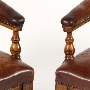 A pair of oak arm chairs -258