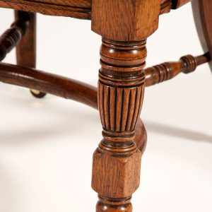 A pair of oak arm chairs -260