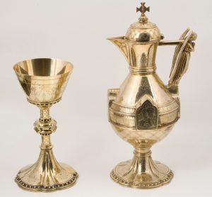 A Gothic Revival silver flagon and chalice designed by G.Goldie-0