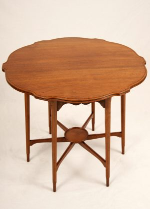 A Morris & Co. walnut occasional table-434