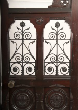 A pair of Gothic Revival doors with wrought iron work-383