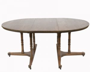 An extending ash dining table-495