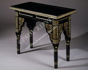 An ebonised and gilded table -0