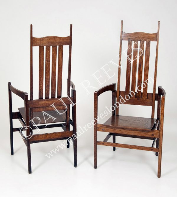 A pair of oak armchairs by C.F.A.Voysey-0