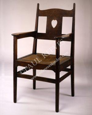 An oak armchair by C.F.A.Voysey-0
