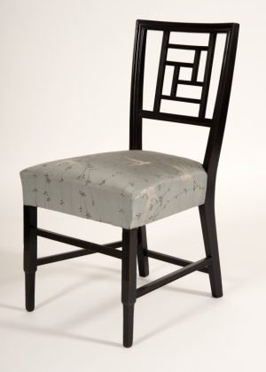 An ebonised side chair -628