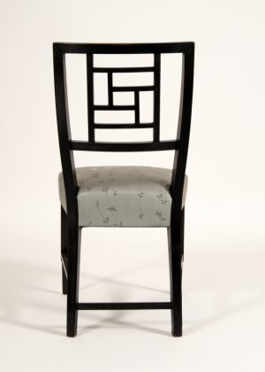 An ebonised side chair -631