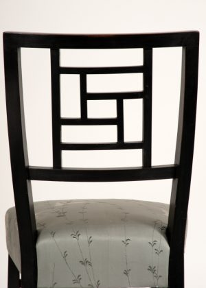 An ebonised side chair -630
