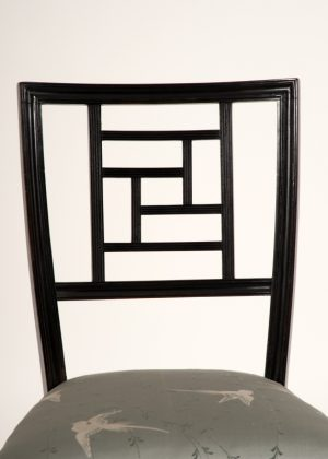 An ebonised side chair -629