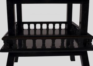 An ebonised table-692