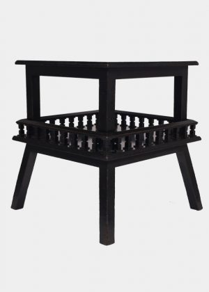 An ebonised table-688