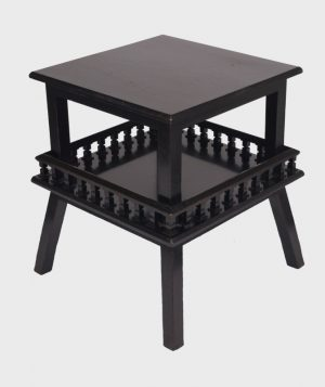 An ebonised table-690