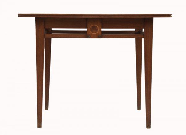 An inlaid oak table -0