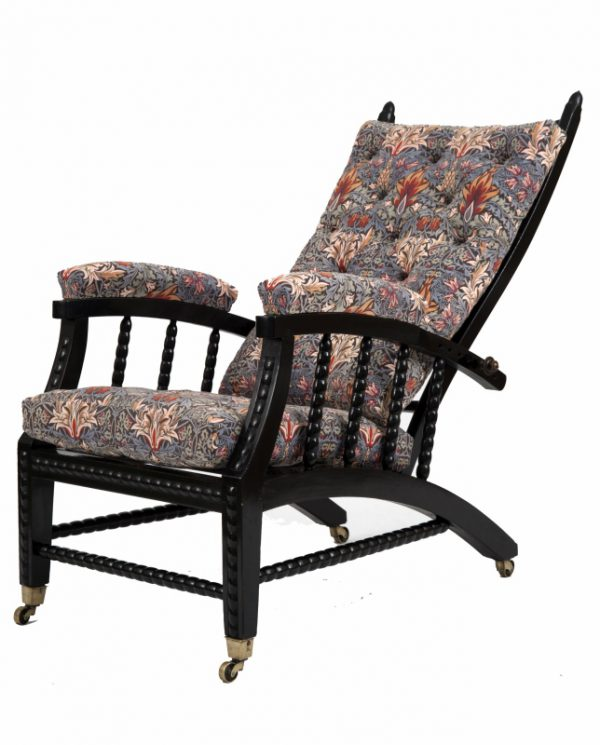 A Morris & Co. ebonised reclining chair -0