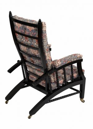A Morris & Co. ebonised reclining chair -1410