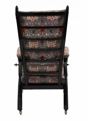 A Morris & Co. ebonised reclining chair -1408