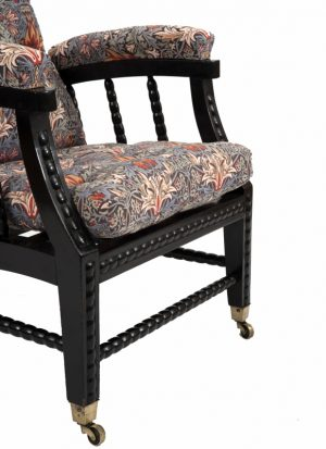 A Morris & Co. ebonised reclining chair -1409