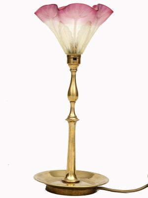 An Arts and Crafts brass table lamp -0