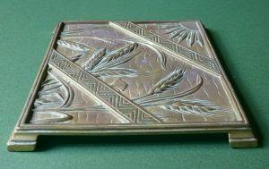 A brass trivet -1436