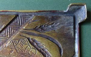 A brass trivet -1440