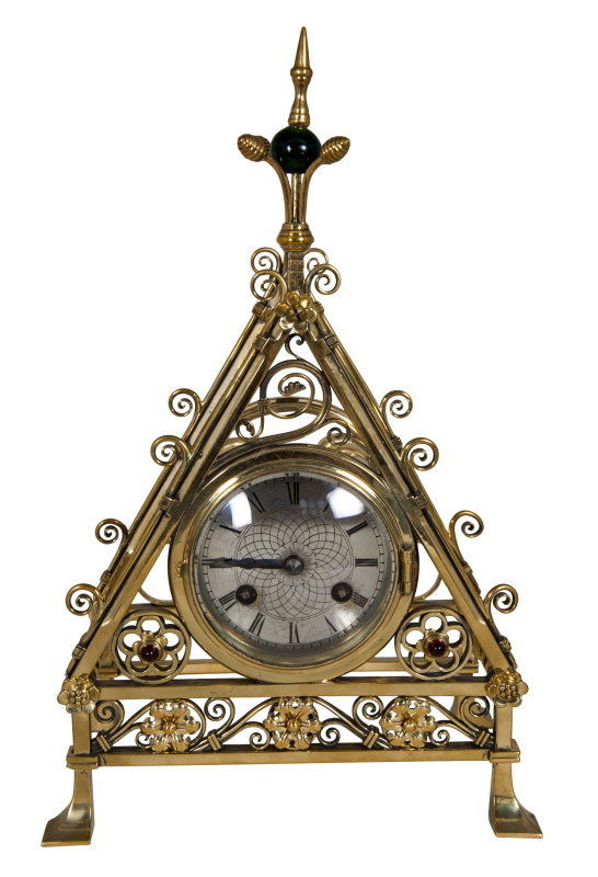A Gothic Revival brass mantlepiece clock-0