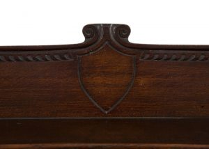 A carved oak side board -1716