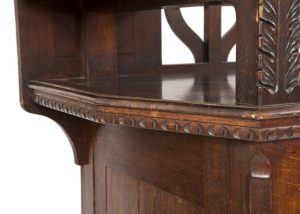 A carved oak side board -1719