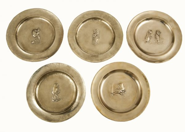 A set of five Alice In Wonderland brass chargers -0