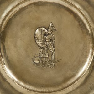 A set of five Alice In Wonderland brass chargers -1759