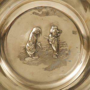 A set of five Alice In Wonderland brass chargers -1761