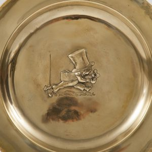 A set of five Alice In Wonderland brass chargers -1766