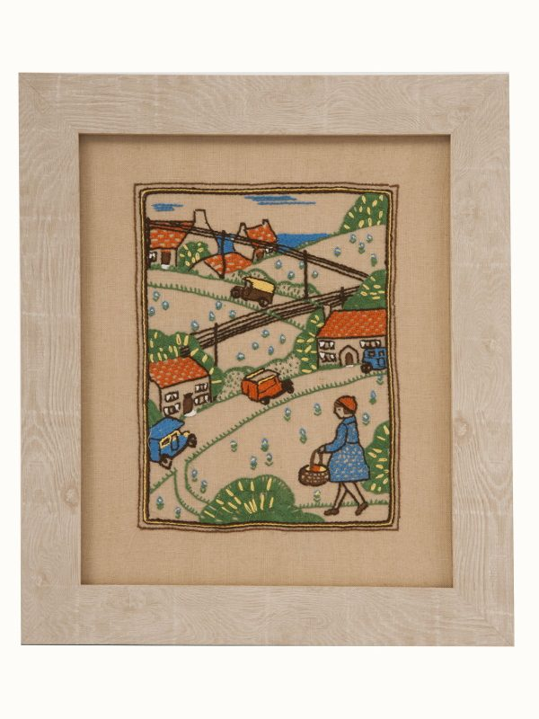 A framed 1930's embroidery -0