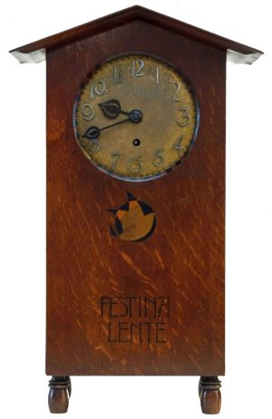 A rare inlaid oak mantle clock -0