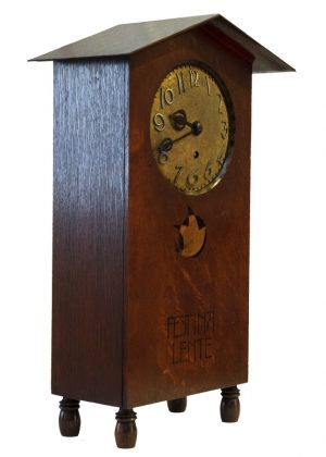 A rare inlaid oak mantle clock -1813