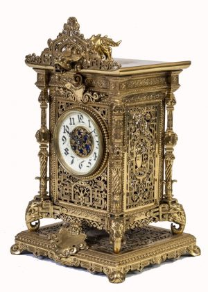 A brass clock garniture by Herbert Mason & Co-1842