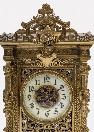A brass clock garniture by Herbert Mason & Co-1856