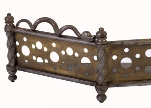 A Gothic Revival iron and brass fender-1861