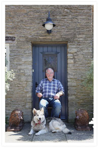 Paul Reeves at his home with his dog
