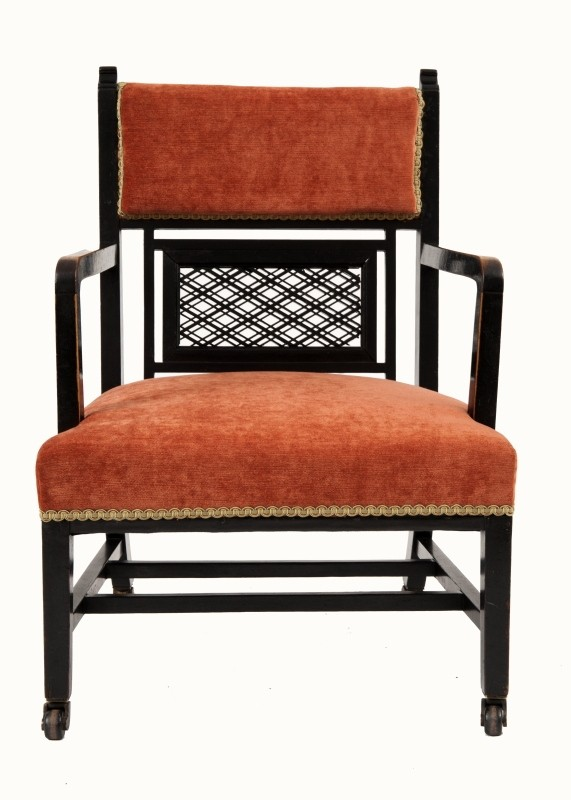 An ebonised Aesthetic Movement armchair positively attributed to H.W. Batley, for Jas Shoolbred & Co.