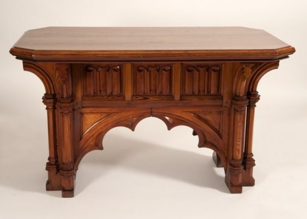 A Gothic Revival pitch pine table of architectural form