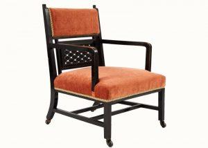 An ebonised Aesthetic Movement armchair