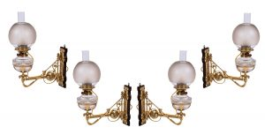 A set of four Gothic Revival wall lights in the style of Dr. Christopher Dresser.