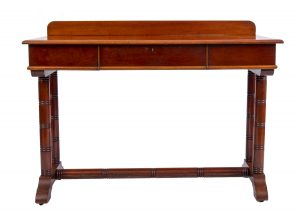A mahogany hall or side table in the style of Philip Webb.