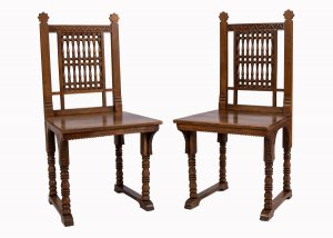 A pair of walnut chairs attributed to Alfred Waterhouse.