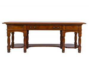An unusual fruitwood library table in the style of Morris & Co.