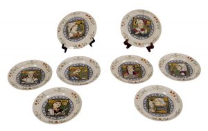 A rare set of eight Minton Medievalist plates, probably designed by Henry Stacy Marks.